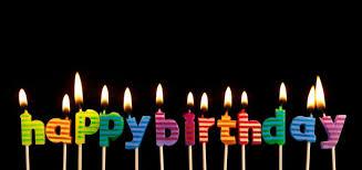 Happy birthday candles lit